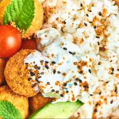 VEGETARIAN - Japanese rice base, homemade falafels, tzatziki sauce, raw vegetables salad, coriander
