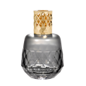 Lampe Berger - The Grey Clarity Lampe Berger designed by Sylvie de France is refined and ethnographic. The universal geometric patterns give texture to its round and iconic form. Its shiny champagne-coloured mount adds the perfect finishing touch.